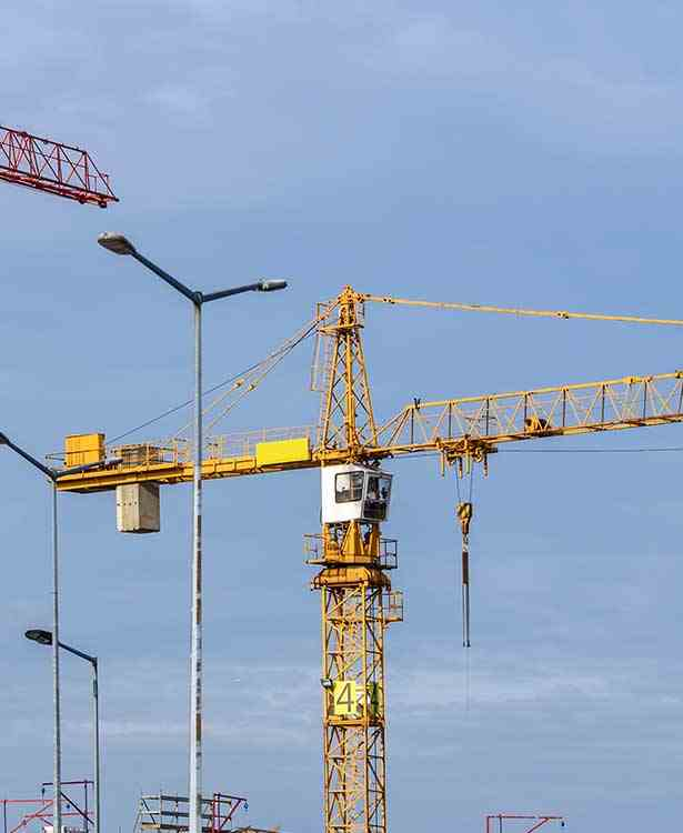 Cranes on a worksite)