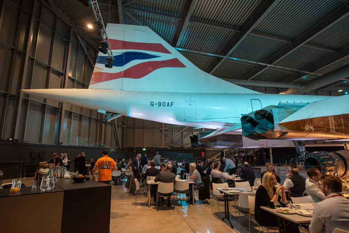 People eating at the GenTech2019 conference under a Concorde plane tail