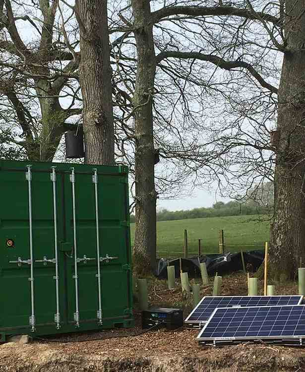 A hybrid generator connected to solar panels)