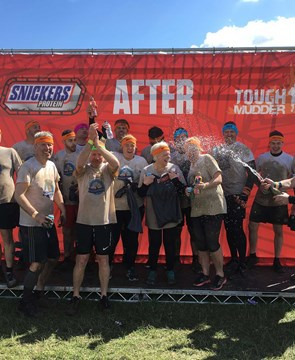 Power Electrics Staff celebrate completing Tough Mudder