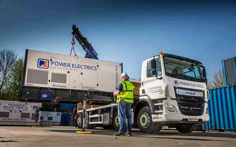 500kVA generator being loaded onto a lorry